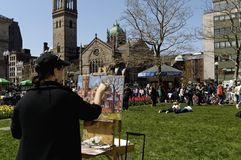 Painting of South Church. Boston, Massachusetts USA - April 28 2013 - Women with easel paints a picture of Old South Church which stands across the street Stock Photos