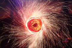 Painting with sparks. A juggler creates a circular painting with sparkling pois. The drawing looks like fictional teleportation door stock photo