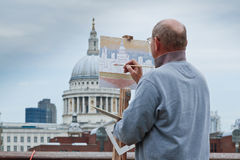 Painting St Pauls cathedral. LONDON, UK - JUNE 19, 2009: Artist Paints St Pauls Cathedral on a canvas from the Southbank Royalty Free Stock Photos