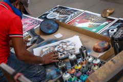 Painting on the street, full of tourists. Royalty Free Stock Images