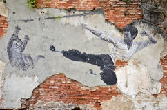 Painting of a street mural painting 'The Real Bruce Lee Would Never do this. PENANG, MALAYSIA - NOV 26, 2015: Painting of a street mural painting 'The Real Bruce Stock Images