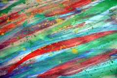 Painting strokes of brush, watercolor hues, abstract background. Red, gree, orange, yellow, violet, blue strokes of brush in watercolor and paint hues. Abstract stock photos