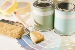 Painting supplies brush, can and swatch Royalty Free Stock Photography
