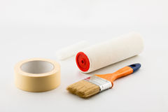 Painting tape, brush, the platen. On a white background Royalty Free Stock Photos