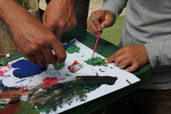 Painting. Teacher teaches children how to paint royalty free stock images