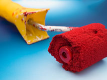 Painting tool. In red acrylic paint Royalty Free Stock Photography