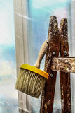 Painting tools - Brush - building industry. Ladder and painting brush. Renovation of old buildings Royalty Free Stock Photo
