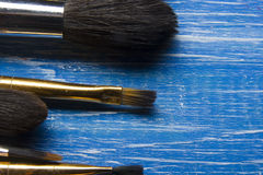 Painting tools colour palette and Artist paint brushes on abstract artistic background Royalty Free Stock Photography
