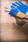 Painting tools paint brushes on duct tape gloves Royalty Free Stock Photography
