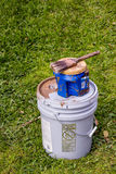 Painting tools. Paint cans and brush are tools for a painting crew Stock Images