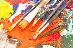 Painting tools on pallet. Painting tools on colorful pallet royalty free stock image