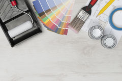 Painting Tools and Architectural Blueprint on Wooden Surface Cop Royalty Free Stock Images