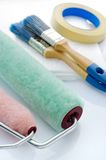 Painting tools on white background. Close up of paint rollers and masking tape, brush, drop cloth, paint roller stock photos