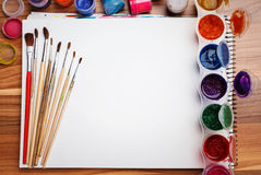 Painting tools on white sheet of paper Stock Image
