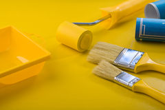 Painting tools on yellow table Royalty Free Stock Photo
