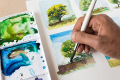 Painting the tree with watercolor. Painting the tree with watercolor, painting the tree, the tree painting stock photo