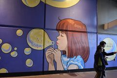 Painting under a bridge. A painting on the wall, about a little girl making bubbles Royalty Free Stock Photo