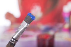 Painting Utensils  in front of colored Pallet Royalty Free Stock Photography