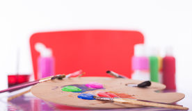 Painting Utensils  in front of colored Pallet Stock Photography