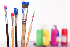 Painting Utensils  in front of colored Pallet Royalty Free Stock Image