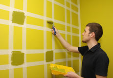 Painting the wall Stock Images