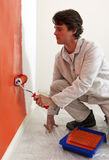 Painting a wall Stock Photography