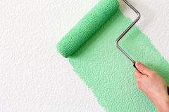 Painting a wall Stock Photos