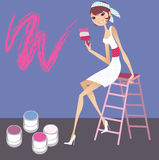 Painting wall. A pretty girl painting or renovating Royalty Free Stock Image