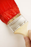 Painting the wall. With red paint Stock Photos