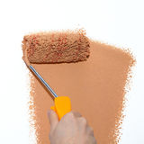Painting a wall brown Royalty Free Stock Image