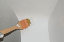 Painting a wall corner with a brush. Painting a wall corner in white with a brush Stock Image