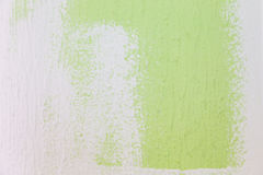 painting a wall from green to white color Royalty Free Stock Photo