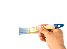 Painting the wall with a paint brush Stock Photo