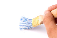 Painting the wall with a paint brush Stock Photos