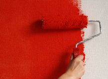 Painting wall in red. Painter painting wall in red Stock Images