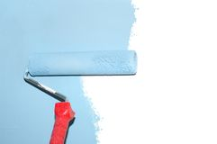 Painting a wall with a roll isolated Stock Image