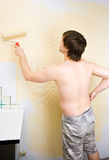 Painting the wall with roller Stock Image