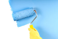 Painting wall with roller Royalty Free Stock Photos