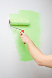 Painting the wall with roller Stock Images