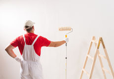 Painting Wall With Roller Royalty Free Stock Photography