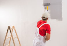 Painting Wall With Roller Royalty Free Stock Image