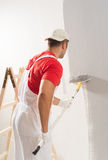 Painting Wall With Roller Royalty Free Stock Images