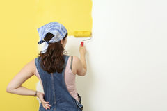 Painting the wall yellow stock photos
