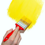 Painting a wall yellow Stock Photography