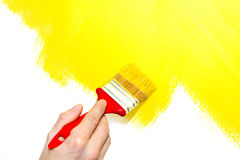 Painting a wall yellow Stock Photo