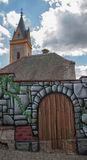 Painting: walls and gates, and the ancient Church in the background Stock Image