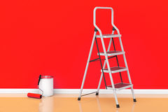 Painting of walls in a red color concept. Paint can with roller Stock Photography