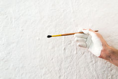 Painting the walls with white paint Stock Photos