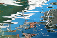 Painting on the Water. The patterns created by the reflections on the sea surface royalty free stock photo