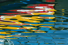 Painting in the water reflections stock images